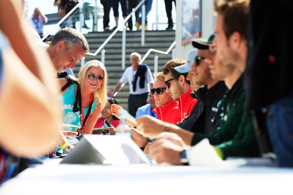 Silverstone, Northamptonshire, England 29th June 2013 Jules Bianchi, Marussia, and Max Chilton, Marussia F1, sign autographs for fans World Copyright: Charles Coates/  ref: Digital Image _X5J2353