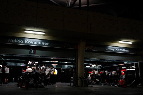 Bahrain International Circuit, Sakhir, Bahrain24th April 2009The McLaren garage at night. Garages. Atmosphere. World Copyright: Charles Coates/LAT Photographicref: Digital Image _26Y0759