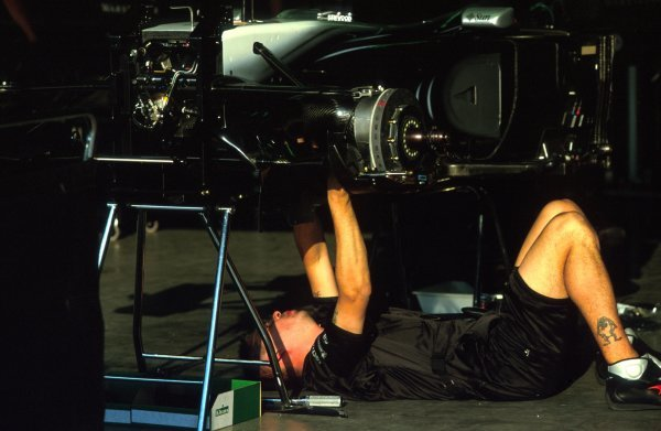 A mechanic works on a McLaren Mercedes MP4-17.