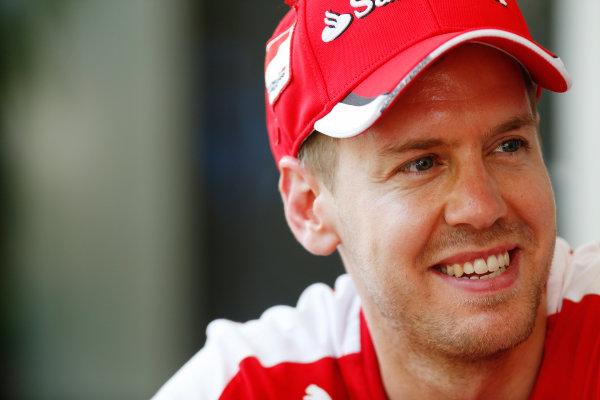 Sepang International Circuit, Sepang, Kuala Lumpur, Malaysia. Thursday 26 March 2015. Sebastian Vettel, Ferrari. World Copyright: Alastair Staley/LAT Photographic. ref: Digital Image _79P0576