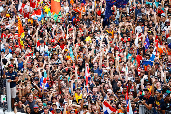 Sepang International Circuit, Sepang, Malaysia. Sunday 1 October 2017. A huge swell of fans celebrate with the top three drivers on the podium. World Copyright: Steven Tee/LAT Images  ref: Digital Image _R3I5754