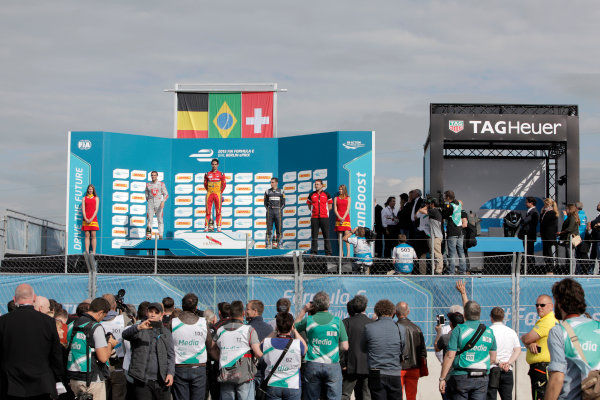 2014/2015 FIA Formula E Championship. Berlin ePrix, Berlin Tempelhof Airport, Germany. Saturday 23 May 2015 Podium. 1st, Lucas di Grassi (BRA)/Audi Abt Sport - Spark-Renault SRT_01E, 2nd, Jerome D'Ambrosio (BEL)/Dragon Racing - Spark-Renault SRT_01E and 3rd, Sebastien Buemi (SWI)/E.dams Renault - Spark-Renault SRT_01E. Photo: Andrew Ferraro/LAT/Formula E ref: Digital Image _MG_7617