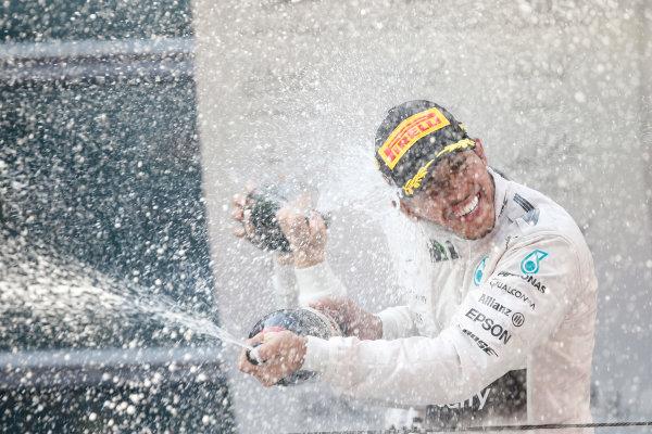 Shanghai International Circuit, Shanghai, China. Sunday 12 April 2015. Lewis Hamilton, Mercedes AMG, 1st Position, sprays Champagne in celebration. World Copyright: Glenn Dunbar/LAT Photographic. ref: Digital Image _W2Q5918