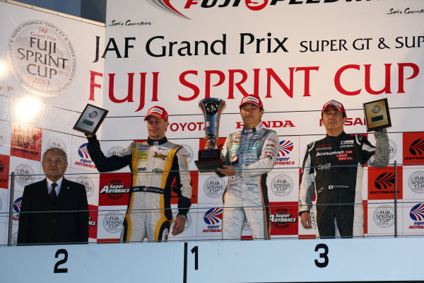 Fuji, Japan. 23rd - 24th November 2013. Rd 7. Fuji Sprint Cup. Winner Yuji Kunimoto ( #39 P.MU/CERUMO·INGING ) 2nd position Loic Duval ( #8 KYGNUS SUNOCO Team LeMans ) 3rd position Tsugio Matsuda ( #20 Lenovo TEAM IMPUL ) podium, portrait. World Copyright: Yasushi Ishihara/LAT Photographic. Ref: 2013JAF_GP_SF_012
