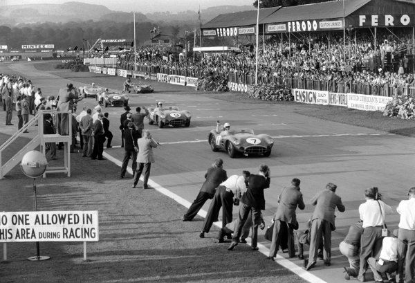 Goodwood, England. 13th September 1958.Stirling Moss / Tony Brooks (Aston Martin DBR1), 1st position, leads Jack Brabham / Roy Salvadori (Aston Martin DBR1), 2nd position, across the finish line, action.World Copyright: LAT PhotographicRef: 8681 - 31.