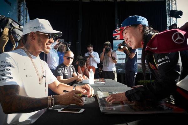 Albert Park, Melbourne, Australia. Thursday 23 March 2017. Lewis Hamilton, Mercedes AMG, signs autographs for fans. World Copyright: Steve Etherington/LAT Images ref: Digital Image SNE23223