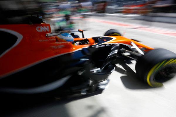 Sochi Autodrom, Sochi, Russia. Friday 28 April 2017. Fernando Alonso, McLaren MCL32 Honda, exits his pit garage. World Copyright: Steven Tee/LAT Images ref: Digital Image _R3I4641