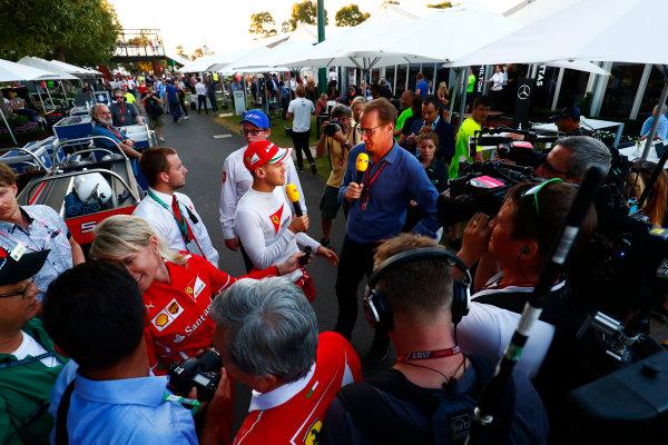 Albert Park, Melbourne, Australia. Sunday 26 March 2017. Race winner Sebastian Vettel, Ferrari, is interviewed by the media. World Copyright: Sam Bloxham/LAT Images ref: Digital Image _J6I5236