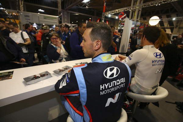 WRC drivers sign autographs.