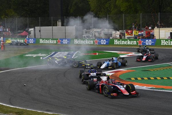 Marino Sato (JPN, Trident), leads Guilherme Samaia (BRA, Charouz Racing System), and Richard Verschoor (NLD, MP Motorsport), past a recovering Dan Ticktum (GBR, Carlin)