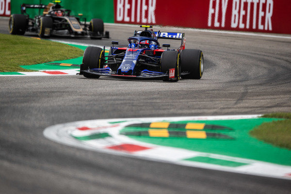 Pierre Gasly, Toro Rosso STR14, leads Kevin Magnussen, Haas VF-19