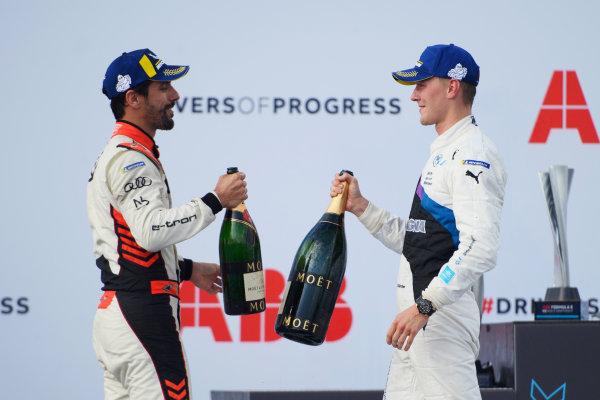 Lucas Di Grassi (BRA), Audi Sport ABT Schaeffler, 3rd position, and Maximilian Guenther (DEU), BMW I Andretti Motorsport, 1st position, congratulate each other on the podium