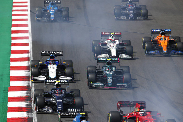 Pierre Gasly, AlphaTauri AT02, leads Sebastian Vettel, Aston Martin AMR21, George Russell, Williams FW43B, Antonio Giovinazzi, Alfa Romeo Racing C41, Daniel Ricciardo, McLaren MCL35M, and Fernando Alonso, Alpine A521