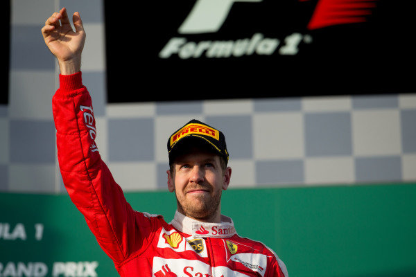 Sebastian Vettel (GER) Ferrari celebrates on the podium at Formula One World Championship, Rd1, Australian Grand Prix, Race, Albert Park, Melbourne, Australia, Sunday 20 March 2016.