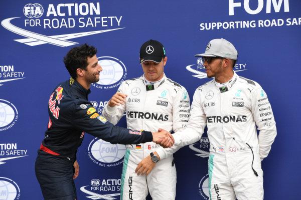 (L to R): Daniel Ricciardo (AUS) Red Bull Racing, pole sitter Nico Rosberg (GER) Mercedes AMG F1 and Lewis Hamilton (GBR) Mercedes AMG F1 celebrate in parc ferme at Formula One World Championship, Rd12, German Grand Prix, Qualifying, Hockenheim, Germany, Saturday 30 July 2016.
