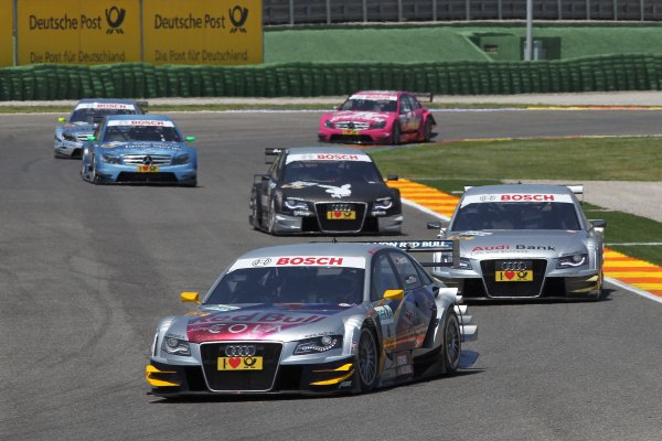 Martin Tomczyk (GER), Audi Sport Team Abt Sportsline, Red Bull Cola Audi A4 DTM (2009) ahead of Miguel Molina (ESP), Audi Sport Rookie Team Abt, Audi Bank A4 DTM (2009) and Markus Winkelhock (GER), Audi Sport Team Rosberg, Playboy Audi A4 DTM (2008).DTM, Rd2, Valencia, Spain. 21-23 May 2010 World Copyright: LAT Photographicref: Digital Image dne1023my55