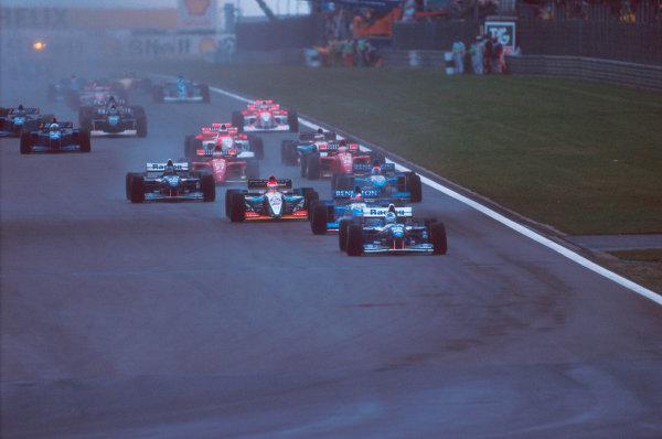 Nurburgring, Germany.29/9-1/10 1995.David Coulthard (Williams FW17B Renault) leads Michael Schumacher (Benetton B195 Renault), Eddie Irvine (Jordan 195 Peugeot), Damon Hill (Williams FW17B Renault) and Johnny Herbert (Benetton B195 Renault) at the start.Ref-95 EUR 06.World Copyright - LAT Photographic