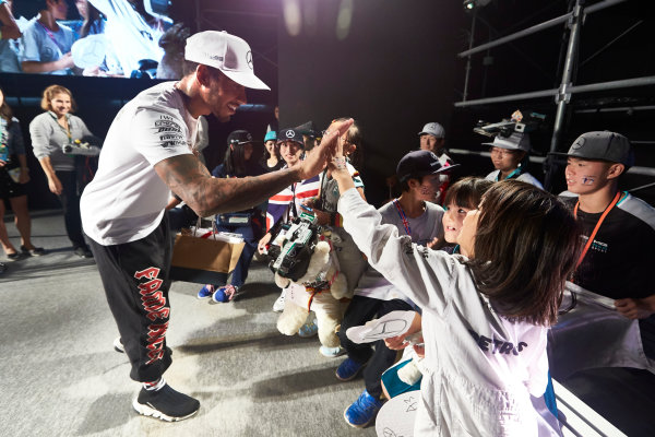 Suzuka Circuit, Japan. Saturday 7 October 2017. Lewis Hamilton, Mercedes AMG, with fans on stage. World Copyright: Steve Etherington/LAT Images  ref: Digital Image SNE14235