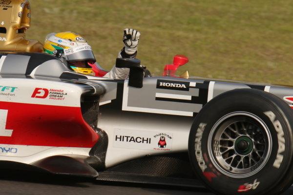 Race winner Naoki Yamamoto, number 16 Team Mugen SF14 Honda, raises his hand in the cockpit.