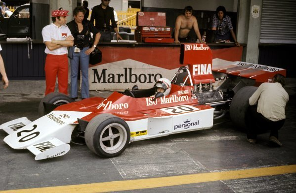 Frank Williams (GBR) Iso Team Owner (Left) watches over adjustments made to the Iso Marlboro-Williams FW of Arturio Merzario (ITA), who retired on lap 20 with a blown engine. Argentinean Grand Prix, Buenos Aires, 13 January 1974. BEST IMAGE