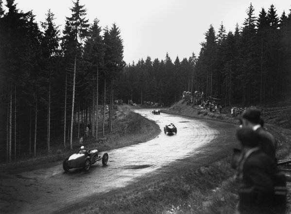 Nurburgring, Germany. 19th July 1931. Cars pass through the forest in the rain, action.  World Copyright: LAT Photographic. Ref:  Autocar Glass Plate B6830