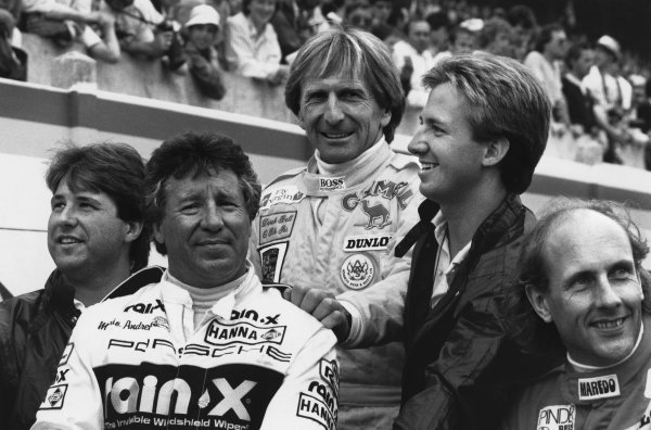 Le Mans, France. 11th - 12th June 1988Hans-Joachim Stuck and Derek Bell with Mario, John and Michael Andretti on the drivers parade, portrait. World Copyright: LAT Photographic.Ref:  B/W Print.