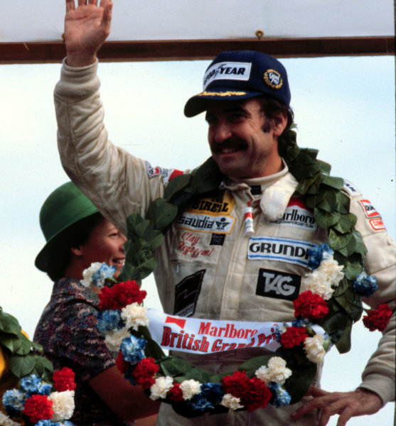 1979 British Grand Prix. Silverstone, England. 12-14 July 1979. Clay Regazzoni (Williams FW07-Ford), 1st position on the podium. This was Williams Grand Prix Engineering's maiden Grand Prix victory.  World Copyright - LAT Photographic