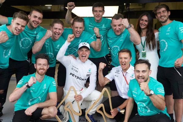 Red Bull Ring, Spielberg, Austria. Sunday 9 July 2017. Valtteri Bottas, Mercedes AMG, 1st Position, celebrates with his team. World Copyright: Steve Etherington/LAT Images ref: Digital Image SNE14784
