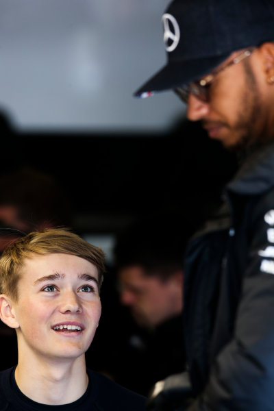 Silverstone, Northamptonshire, UK.  Friday 14 July 2017. Lewis Hamilton, Mercedes AMG, talks with racing driver Billy Monger. World Copyright: Charles Coates/LAT Images  ref: Digital Image DJ5R2705