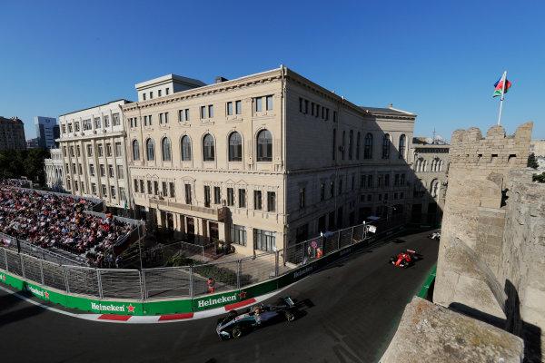 Baku City Circuit, Baku, Azerbaijan. Sunday 25 June 2017. Lewis Hamilton, Mercedes F1 W08 EQ Power+, leads Sebastian Vettel, Ferrari SF70H and Felipe Massa, Williams FW40 Mercedes.  World Copyright: Zak Mauger/LAT Images ref: Digital Image _54I4551