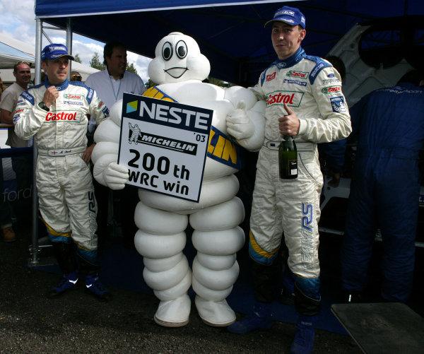 2003 FIA World Rally Champs. Round nine, Neste Rally Finland. Rally7th-10th August 2003.Markko Martin (R) & Co-driver Michael Park (L) celebrate Michelin's 200th win in the WRC. World Copyright: McKlein/LAT