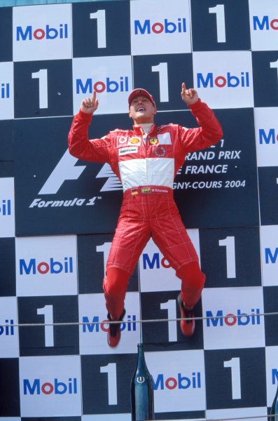 2004 French Grand Prix Magny-Cours, France. 2nd - 4th July Michael Schumacher, Ferrari F2004 leaps on the top step of the podium to celebrate his victory.  World Copyright: LAT Photographic Ref:35mm Image A07