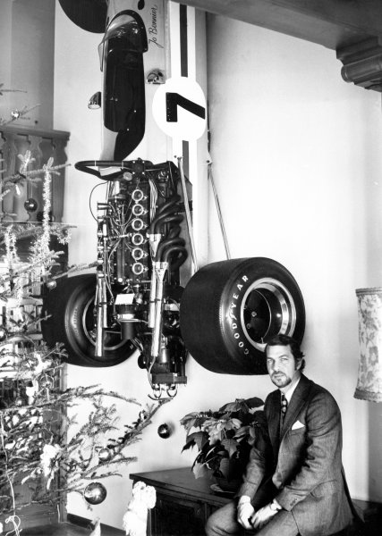Jo Bonnier poses next to Christmas Tree with car hanging on wall behind him.World Copyright: LAT Photographic.ref: 50mb Scan.