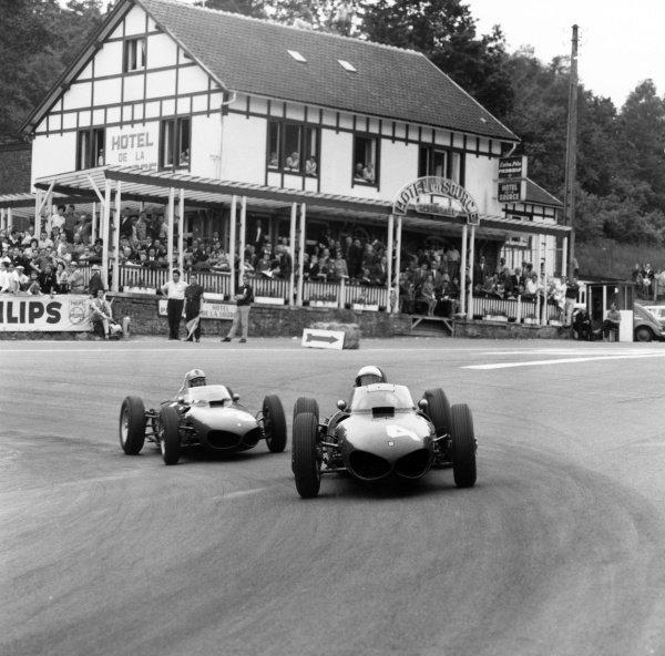 1961 Belgian Grand Prix.Spa-Francorchamps, Belgium. 18 June 1961.Phil Hill, Ferrari Dino 156, 1st position, leads Wolfgang von Trips, Ferrari Dino 156, 2nd position, at La Source, action.World Copyright: LAT PhotographicRef: 9180