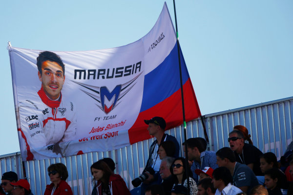 Sochi Autodrom, Sochi, Russia. Sunday 12 October 2014. Support for Jules Bianchi, Marussia F1. World Copyright: Andy Hone/LAT Photographic. ref: Digital Image _ONY7798