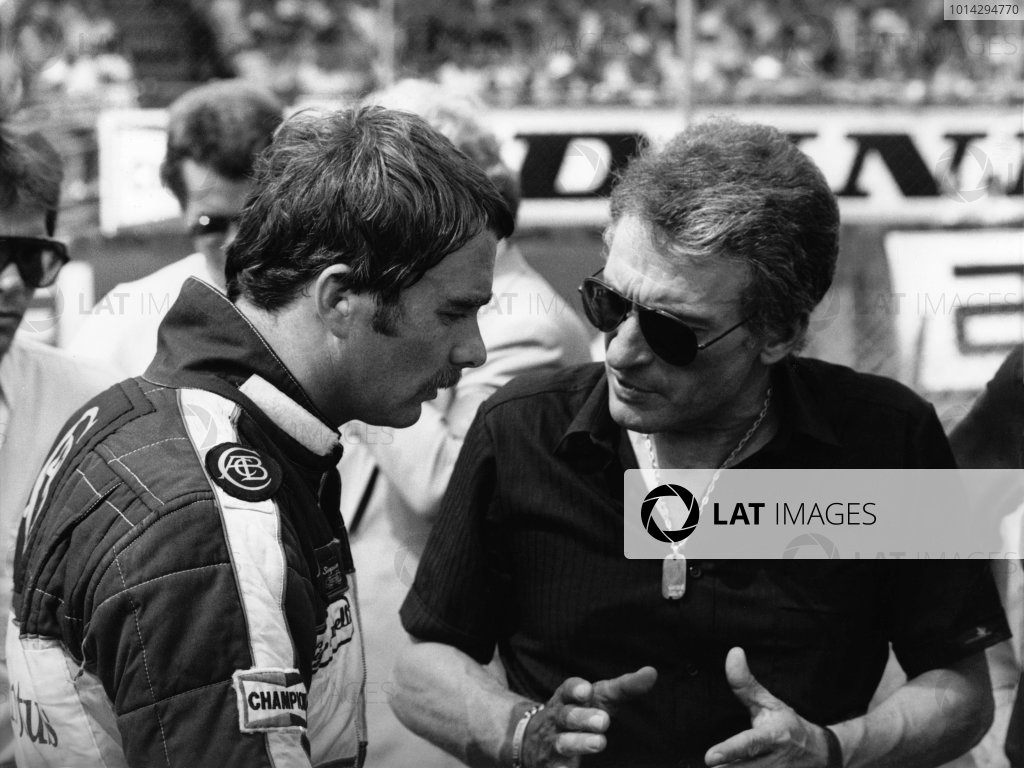 1984 British Grand Prix. Brands Hatch, England. 20-22 July 1984. Nigel Mansell (Lotus 95T Renault), retired, chats to designer, Gerard Ducarouge before the start of the race, portrait. World Copyright: LAT Photographic.  Ref:  B/W Print.
