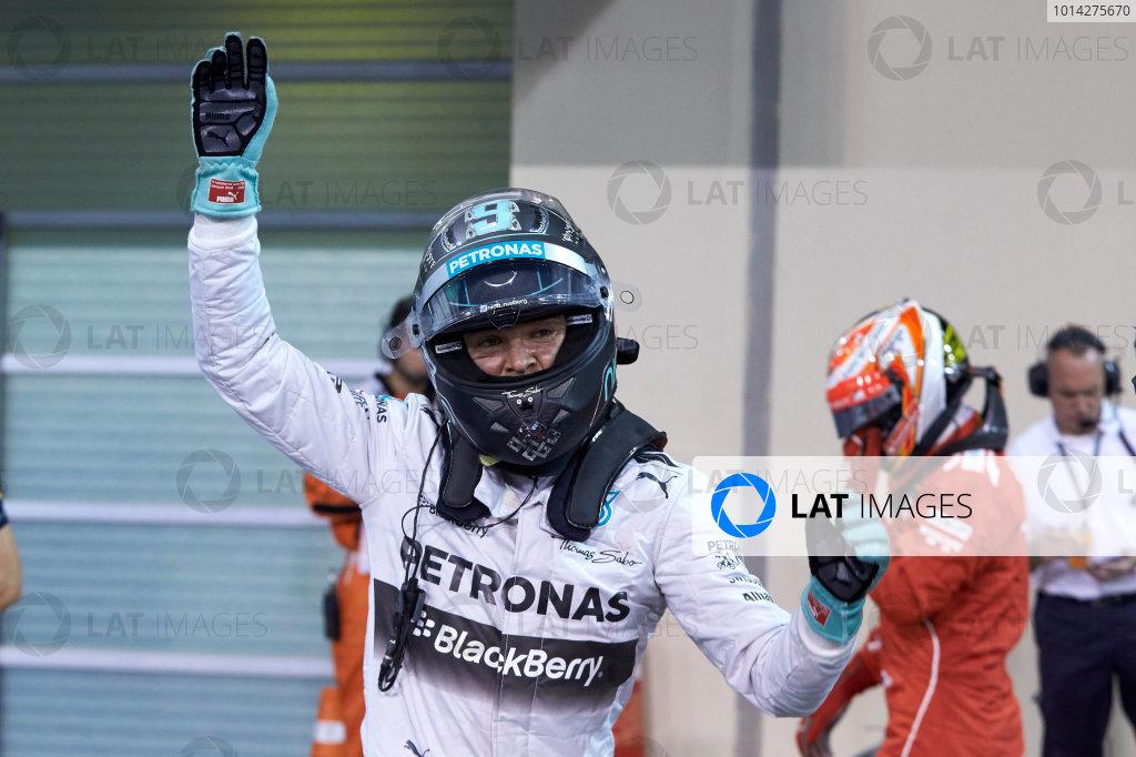 Yas Marina Circuit, Abu Dhabi, United Arab Emirates. Saturday 22 November 2014. Nico Rosberg, Mercedes AMG, celebrates pole in Parc Ferme. World Copyright: Steve Etherington/LAT Photographic. ref: Digital Image SNE12254