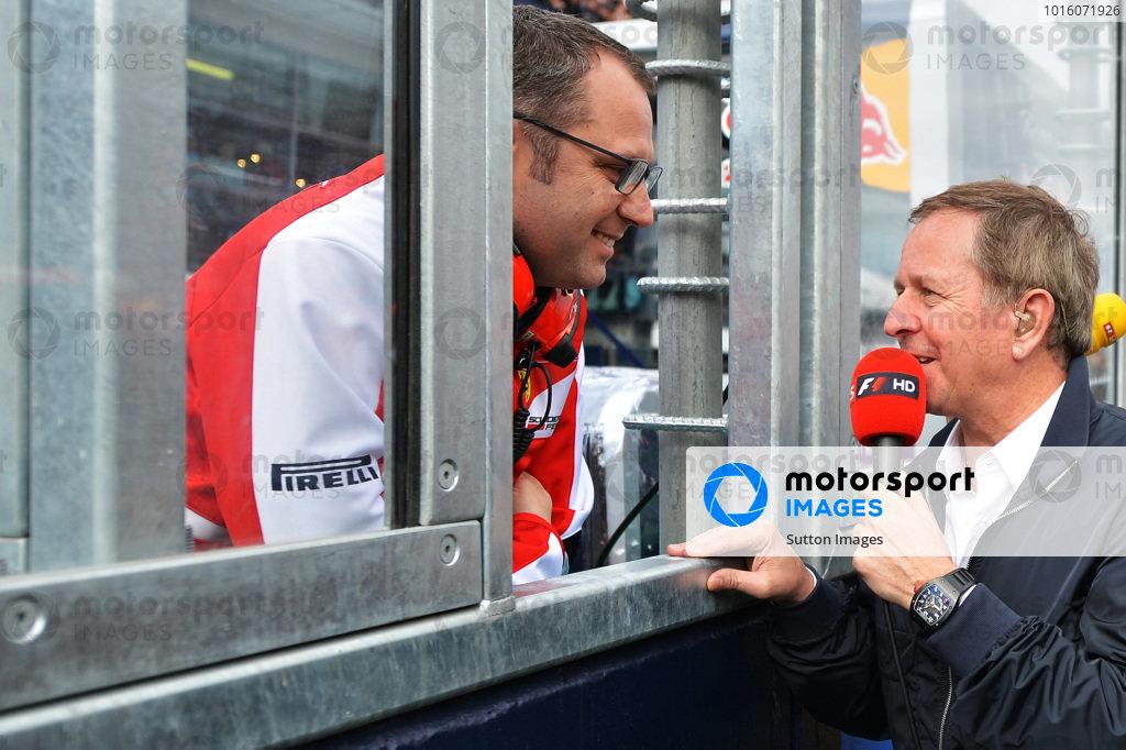 Martin Brundle (GBR) Sky TV talks with Stefano Domenicali (ITA) Ferrari General Director on the grid.Formula One World Championship, Rd1, Australian Grand Prix, Race, Albert Park, Melbourne, Australia, Sunday 17 March 2013.