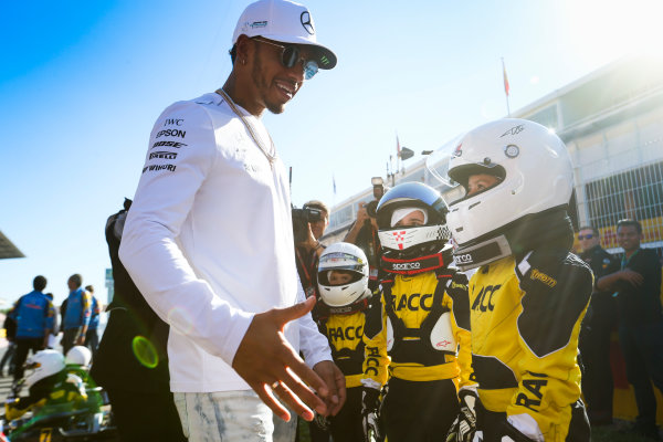 Circuit de Catalunya, Barcelona, Spain. Thursday 11 May 2017. Lewis Hamilton, Mercedes AMG, meets some junior RACC Karter. World Copyright: Dom Romney/LAT Images ref: Digital Image AM1T9968