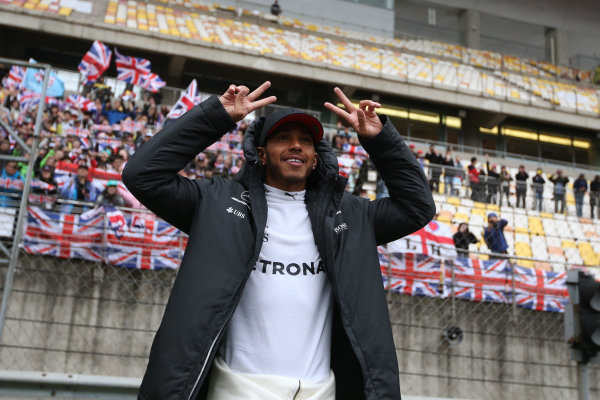 Shanghai International Circuit, Shanghai, China.  Sunday 09 April 2017.  Lewis Hamilton, Mercedes AMG, celebrates victory in front of a grandstand adorned by British flags. World Copyright: Charles Coates/LAT Images  ref: Digital Image AN7T0909