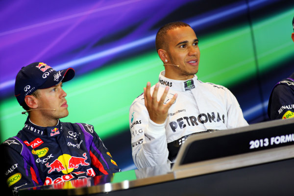 Spa-Francorchamps, Spa, Belgium. 24th August 2013. Front row starters Lewis Hamilton, Mercedes AMG, and Sebastian Vettel, Red Bull Racing, in the Press Conference. World Copyright: Sam Bloxham/LAT Photographic. ref: Digital Image IMG_8075.