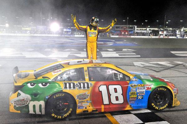 30 August - 1 September 2013, Hampton, Georgia, USA Kyle Busch, M&M's Toyota Camry celebrates his win with a burnout © 2013, Nigel Kinrade LAT Photo USA