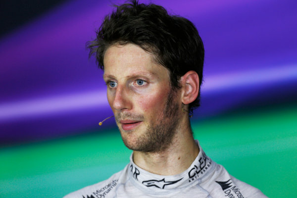 Marina Bay Circuit, Singapore. Saturday 21st September 2013.  Romain Grosjean, Lotus F1, in the press conference after qualifying.  World Copyright: Charles Coates/LAT Photographic. ref: Digital Image _N7T5341
