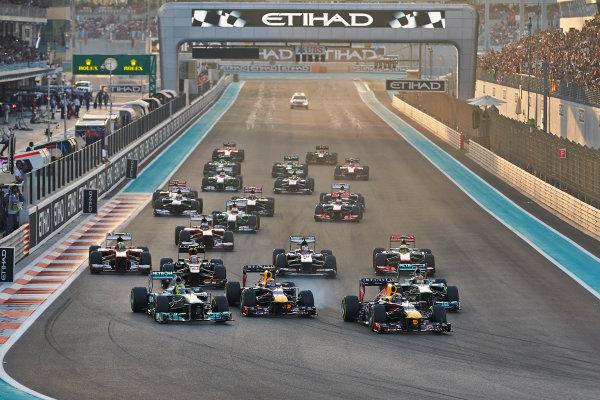 Yas Marina Circuit, Abu Dhabi, United Arab Emirates. Sunday 3rd November 2013. Sebastian Vettel, Red Bull RB9 Renault, leads the field in to the first corner. World Copyright: Steve Etherington/LAT Photographic. ref: Digital Image SNE23896 copy
