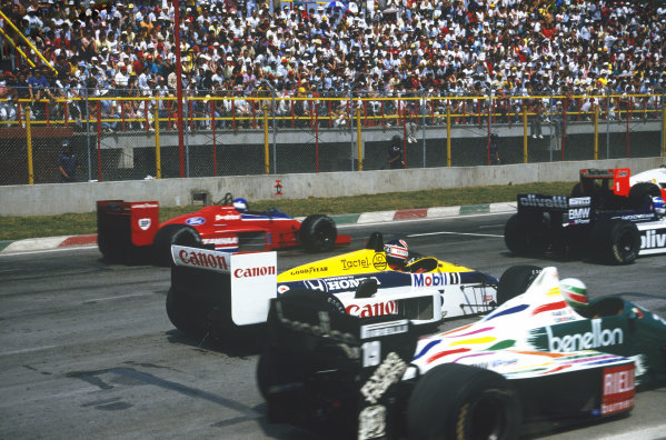 1986 Mexican Grand Prix  Mexico City, Mexico. 9-12th October 1986.  Nigel Mansell, Williams FW11 Honda, stuck in neutral at the start as Derek Warwick, Brabham BT55 BMW, Patrick Tambay, Lola THL-2 Ford, and Teo Fabi, Benetton B186 BMW, go past. From 3rd position on the grid Mansell ended the first lap in 18th position.  Ref: 86MEX08. World copyright: LAT Photographic