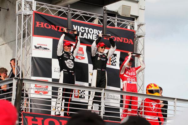 25-26 April, 2015, Birmingham, Alabama USA Josef Newgarden, Graham Rahal, Scott Dixon celebrate on the podium. ?2015, Sam Cobb LAT Photo USA