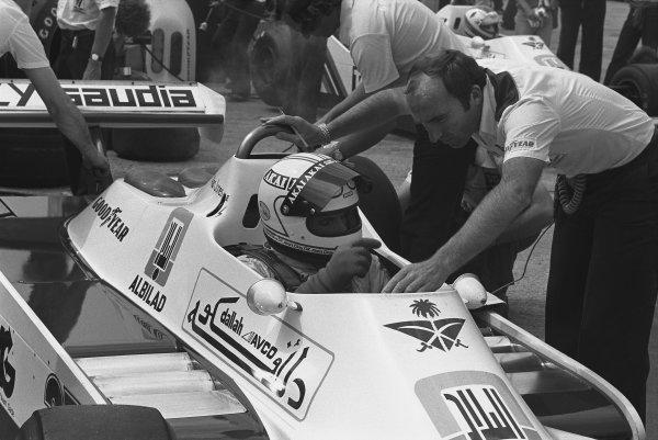 1979 British Grand Prix. Silverstone, England. 12th - 14th July 1979. Frank Williams talks to Alan Jones (Williams FW07-Ford), retired, portrait.  World Copyright: LAT Photographic. Ref:  12742 - 21A.