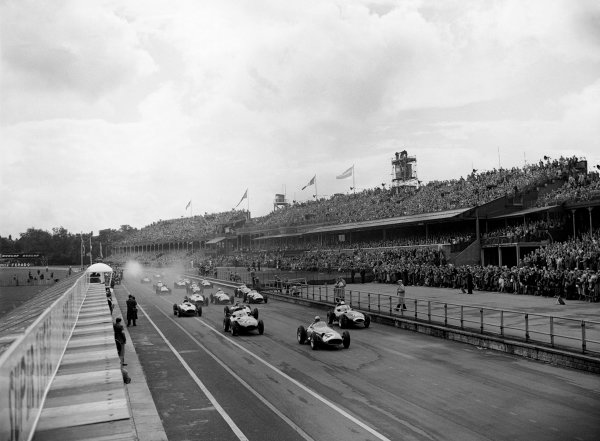 Aintree, England. 18th - 20th July 1957.Jean Behra (Maserati 250F), retired, leads at the start, with Stirling Moss (Vanwall VW4), 1st position and Tony Brooks (Vanwall VW4), retired, close behind, action. World Copyright: LAT Photographic.Ref:  B/WPRINT.
