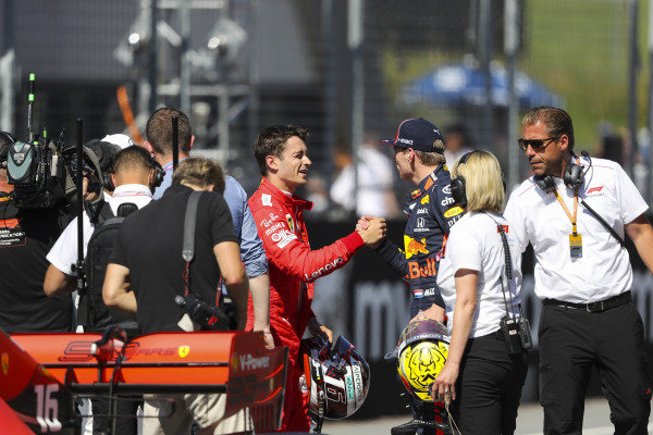 Max Verstappen, Red Bull Racing, congratulates Charles Leclerc, Ferrari, on pole