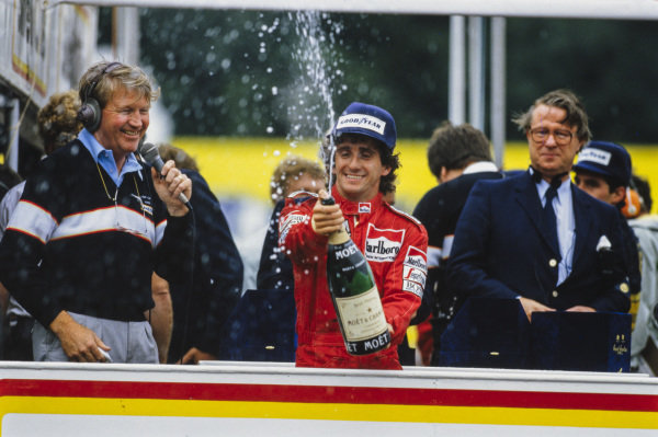 Newly-crowned world champion Alain Prost, 4th position, celebrates on the podium by spraying champagne.